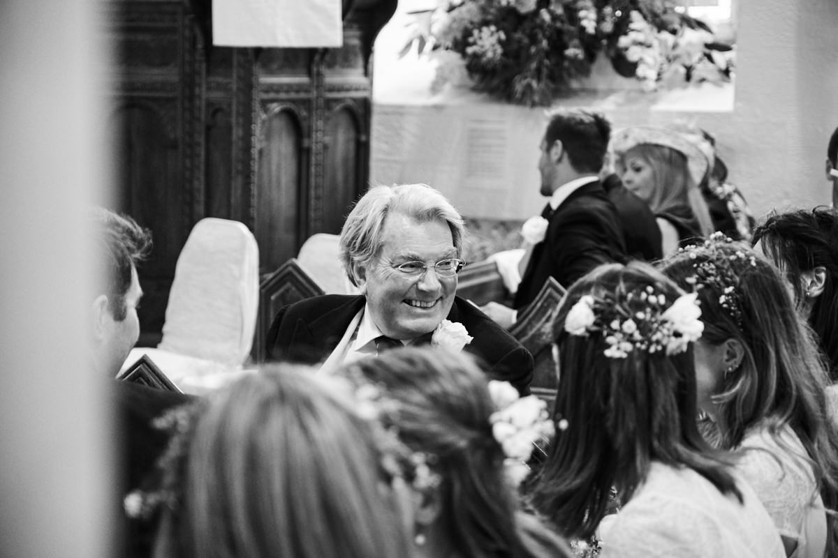 the bride's father laughing