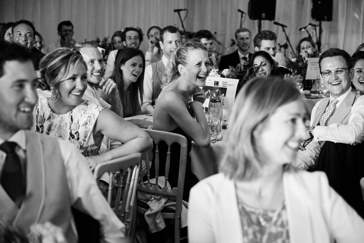 guests laughing at the father of the bride speech