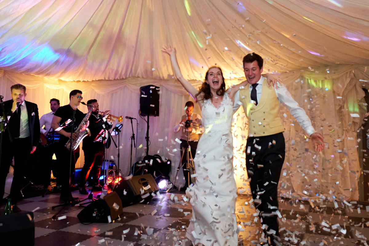 confetti on the dance floor at a Sussex marquee wedding