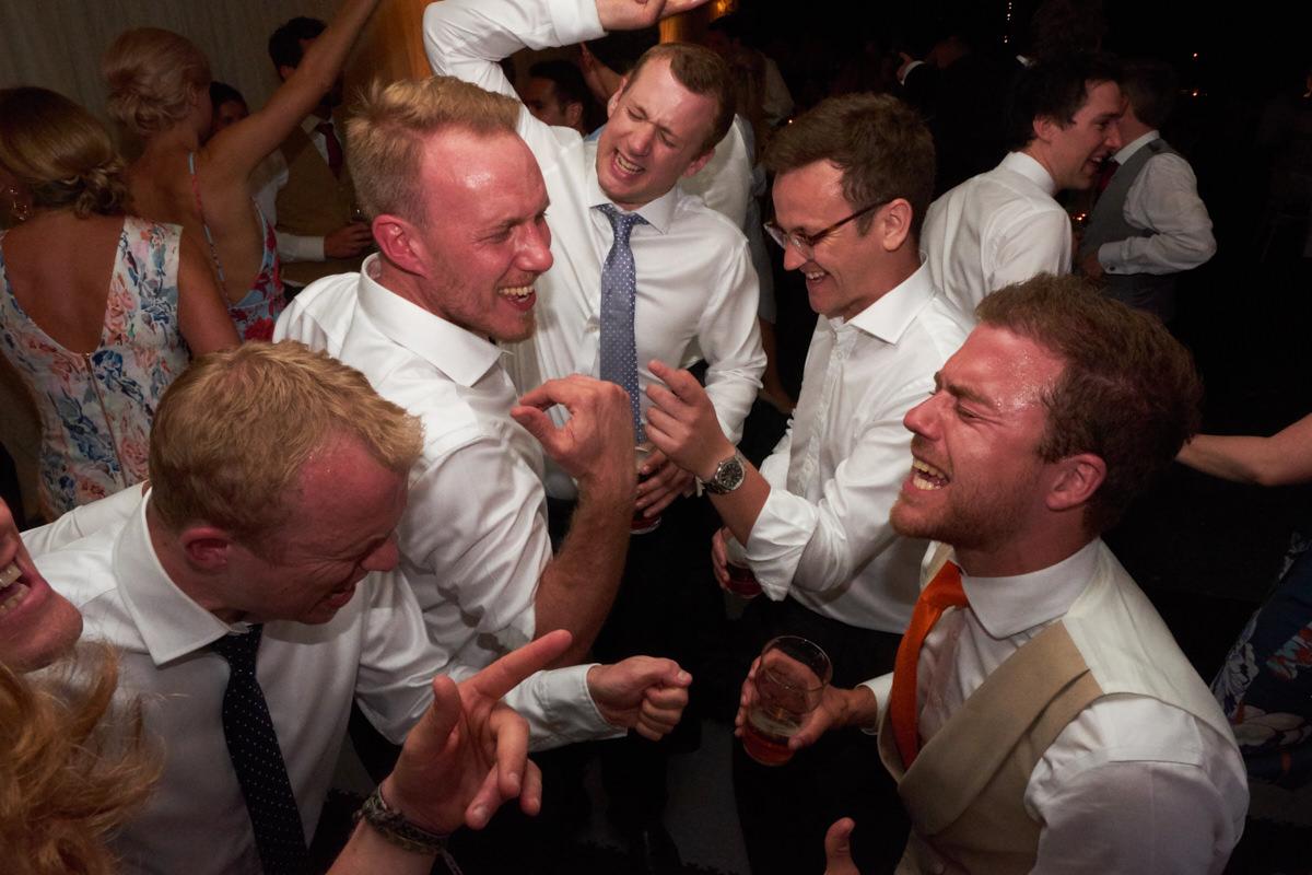 groomsmen dancing
