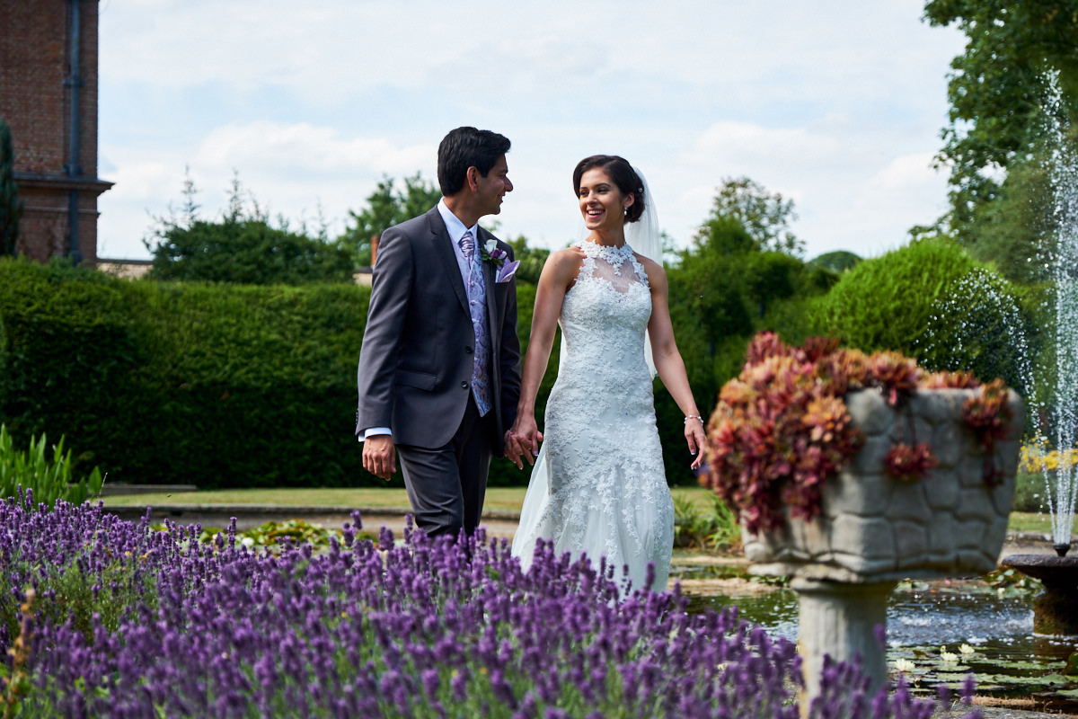 a bride and groom talking at their Horwood House wedding