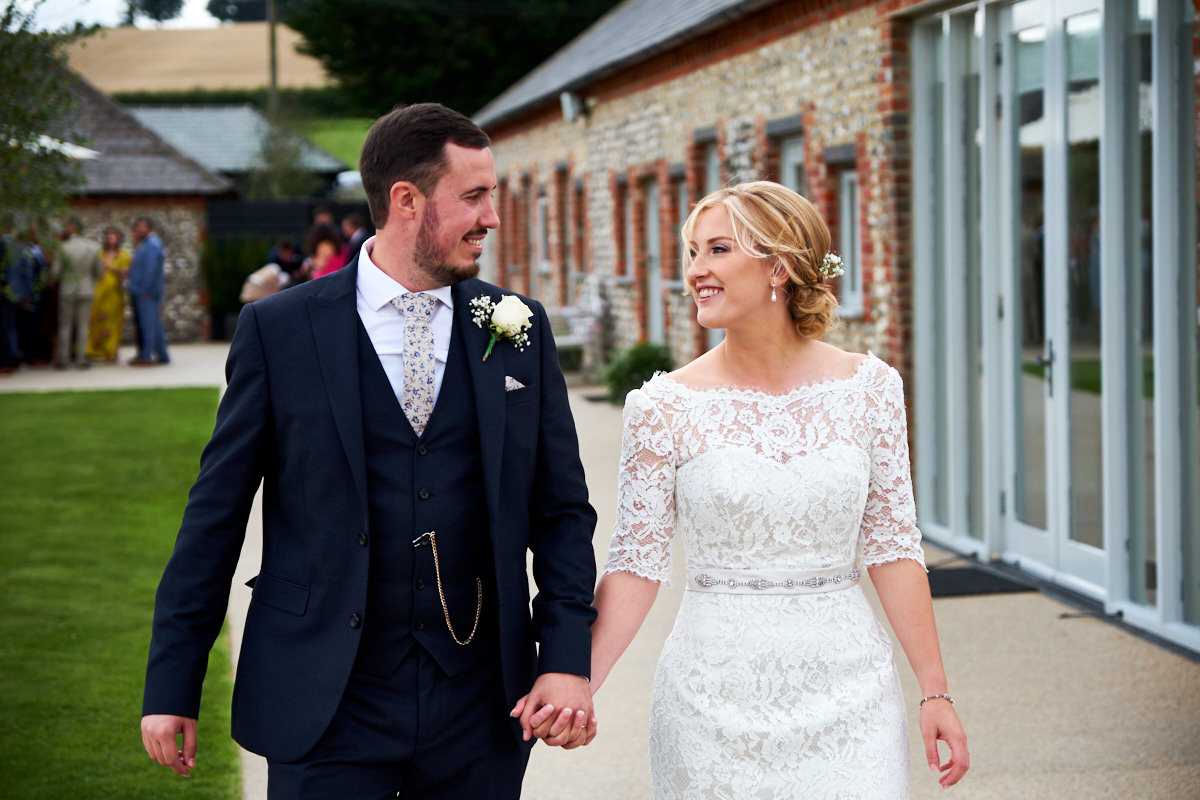 a bride and groom at Farbridge in Sussex walking together