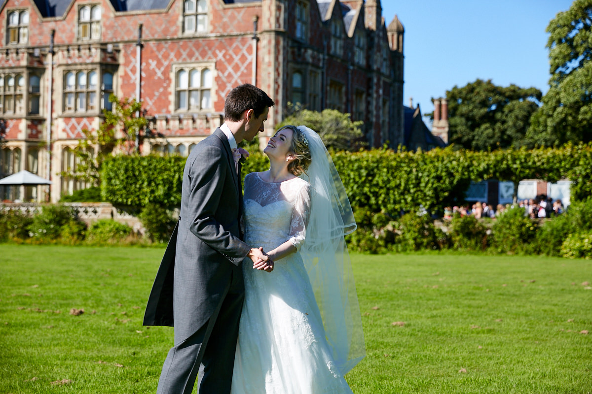 a bride and groom laughing at their Sussex wedding at Horsted Place