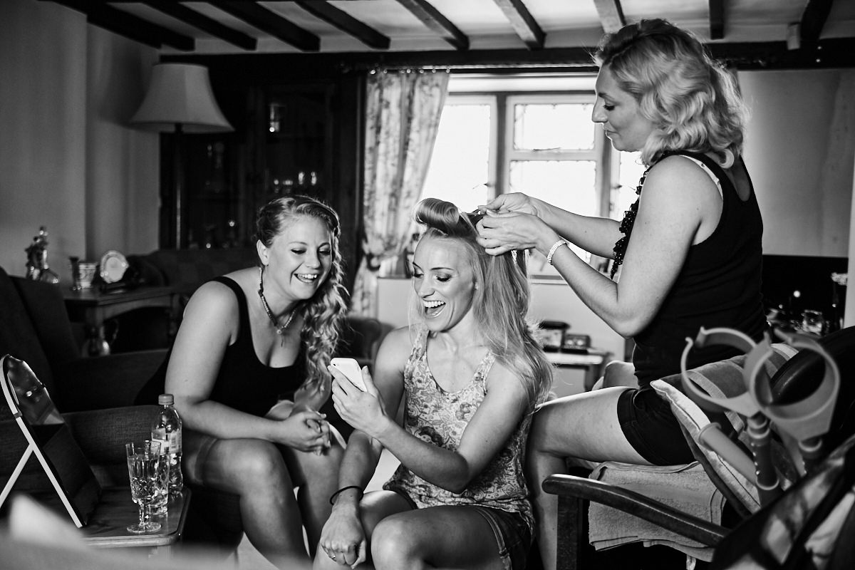 the bride having her hair done for her wedding day in West Sussex