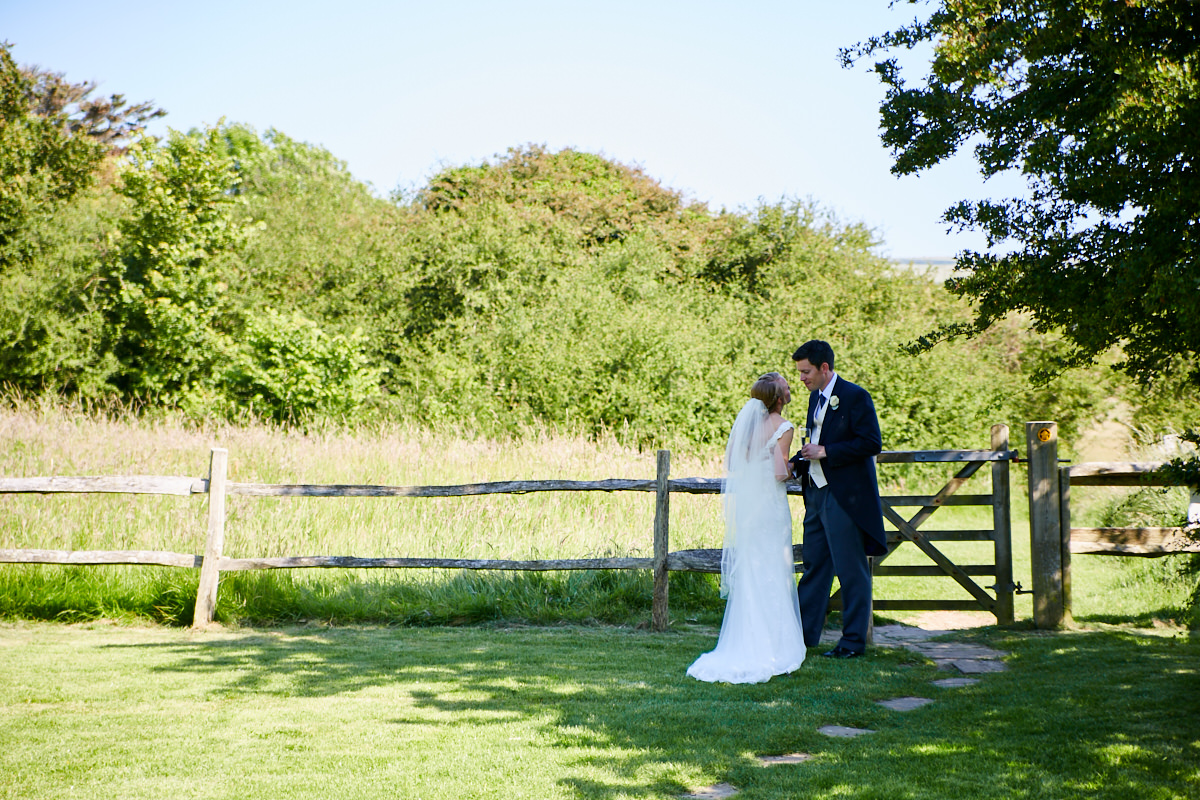 the bride and groom together in a field in Sussex