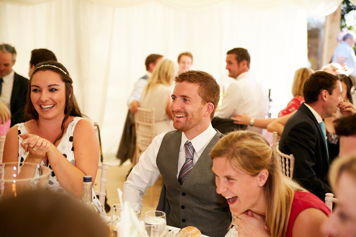 guests laughing at a Sussex wedding