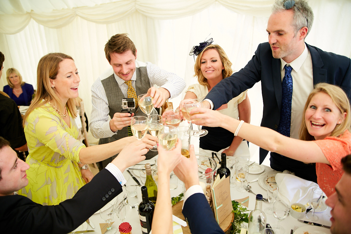 guests cheer and make a toast at this Sussex wedding breakfast