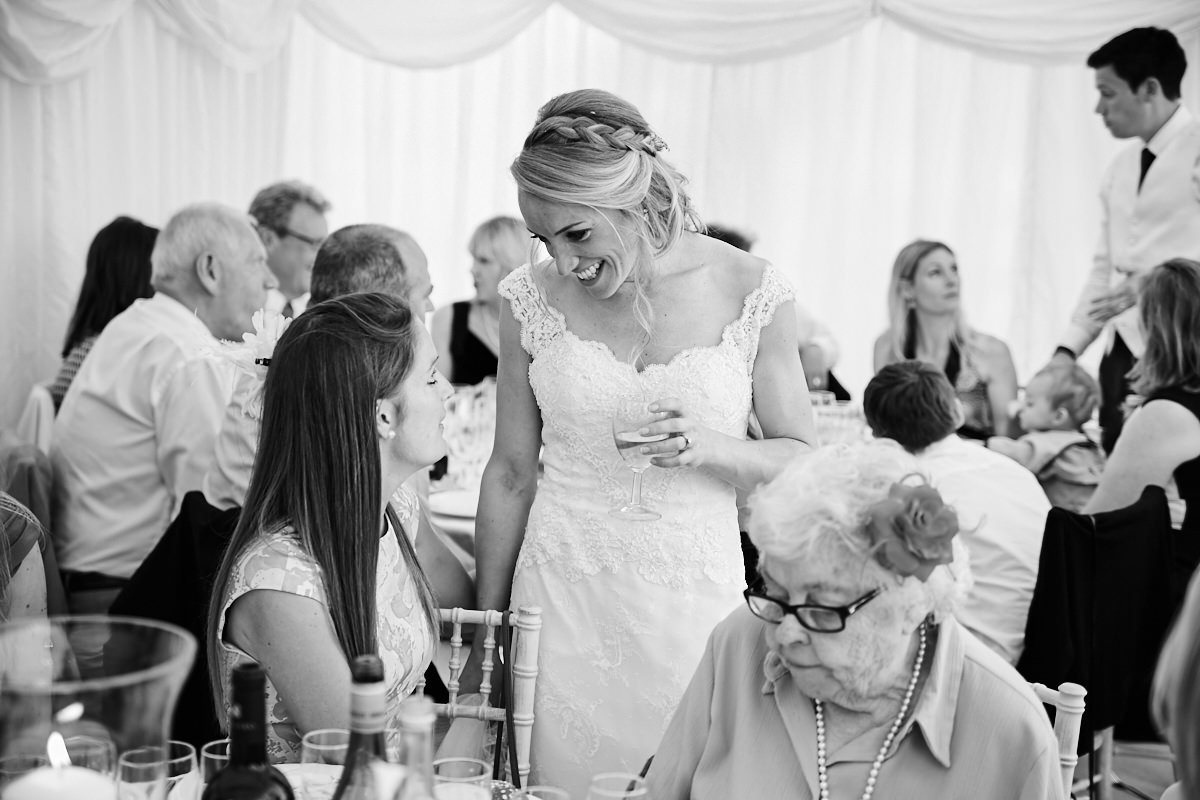 the bride shares a moment with a guest at her wedding
