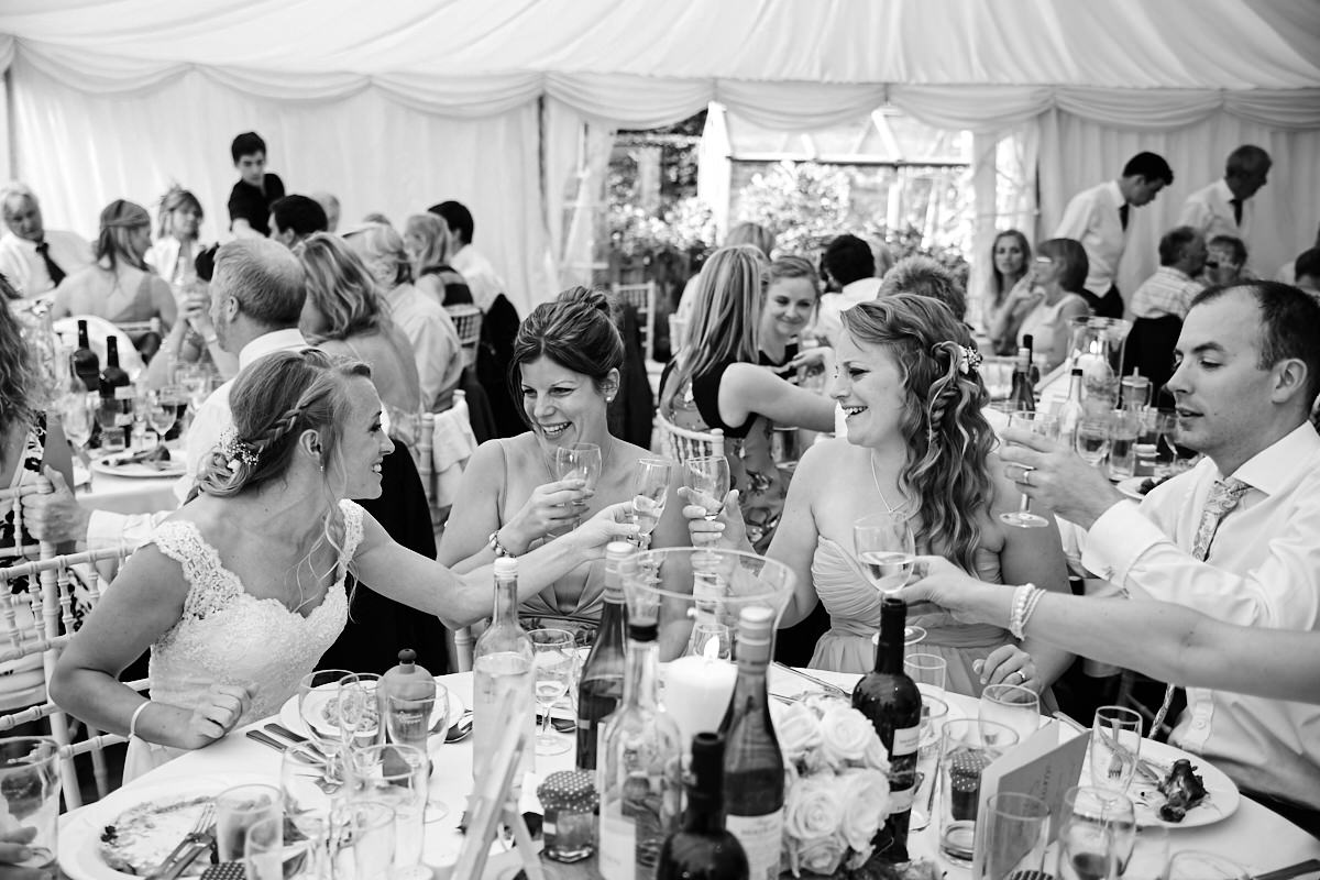 guests laughing and joking at a wedding