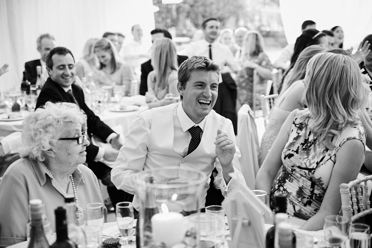 the bride's brother laughing at his father's speech
