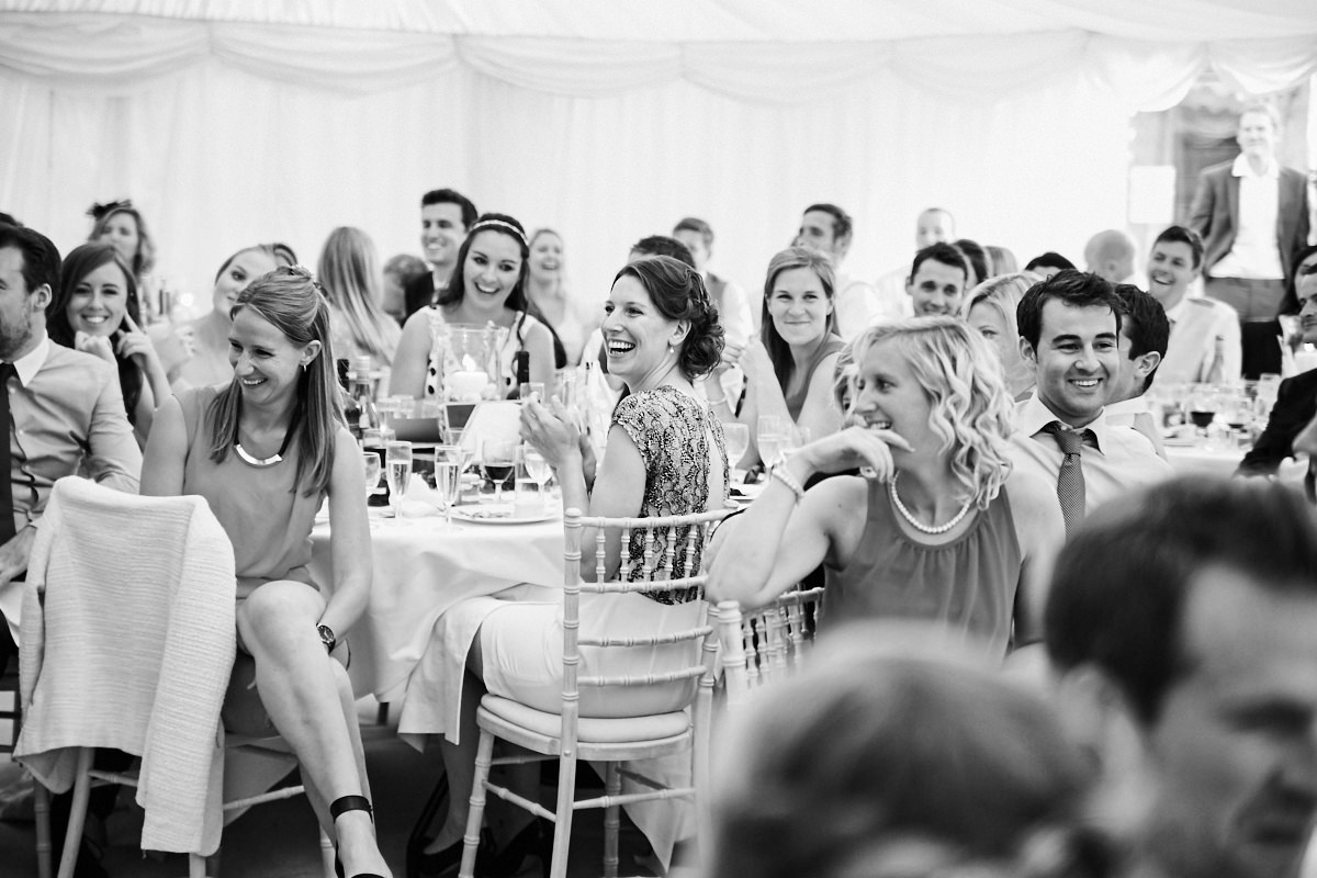 guests laughing at the best man's speech at this Sussex wedding