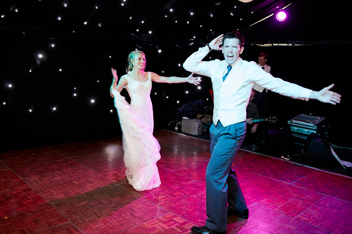 the bride and groom dancing at their Sussex wedding