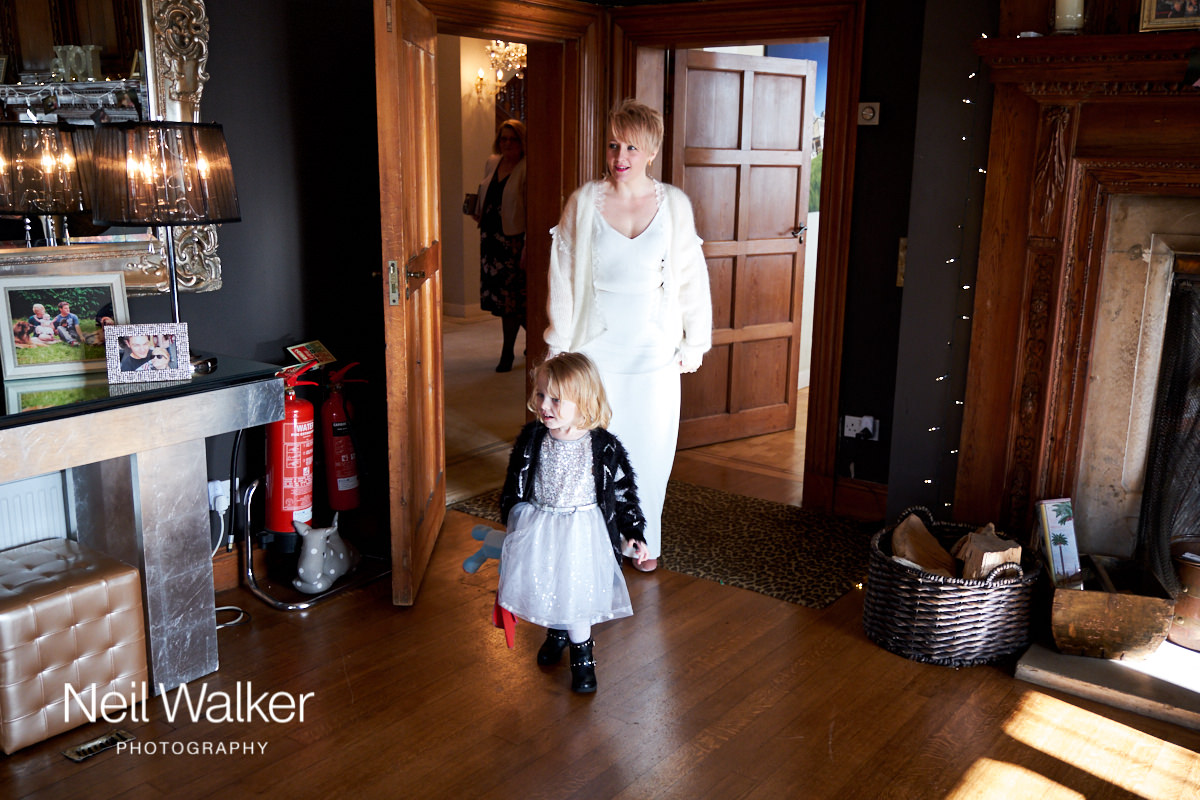 the bride and her daughter look around Greyfriars House to make sure everything is ready for the wedding ceremony