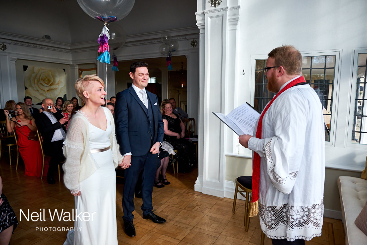 the bride and groom getting married at Greyfriars House