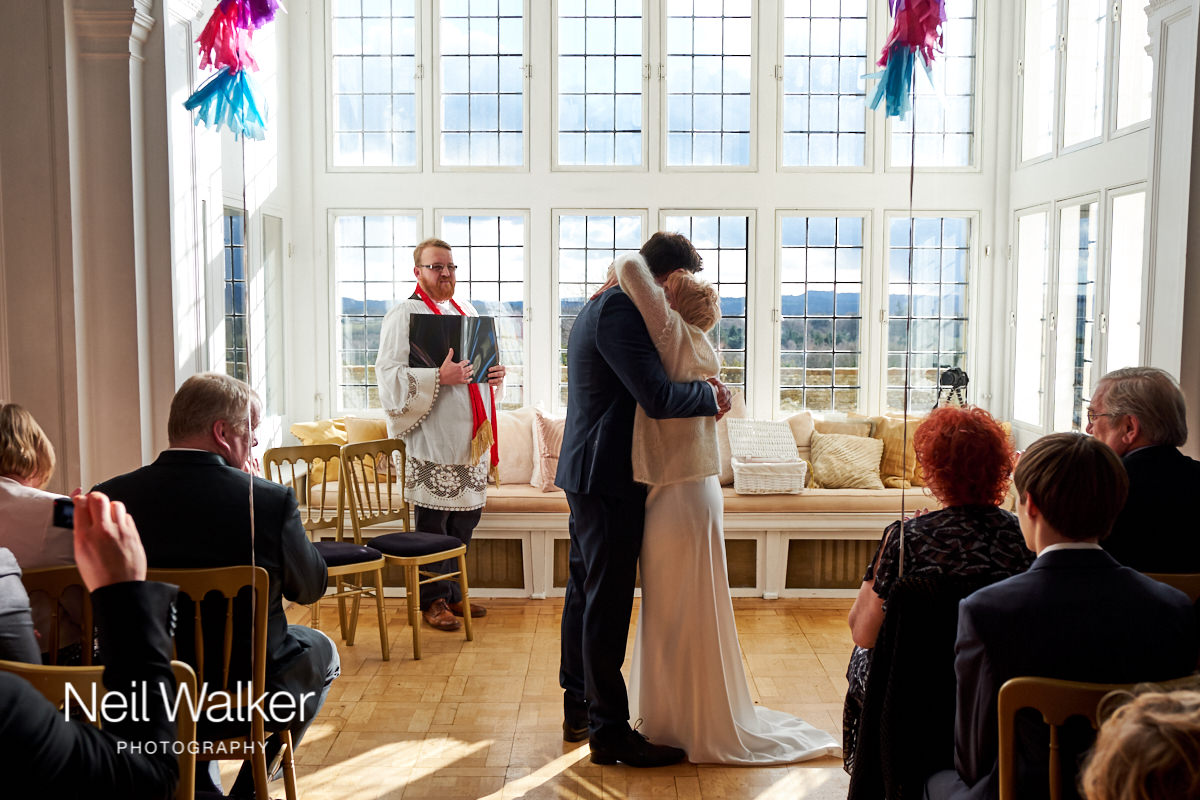 the bride and groom hugging