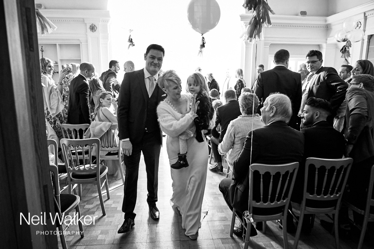 the bride and groom leaving the Drawing Room at Greyfriars House after their wedding ceremony