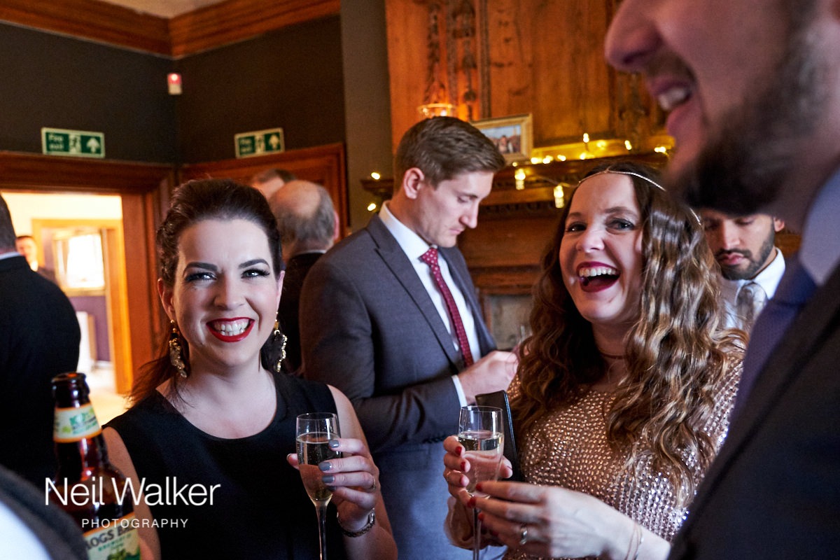 guests laughing in the bar