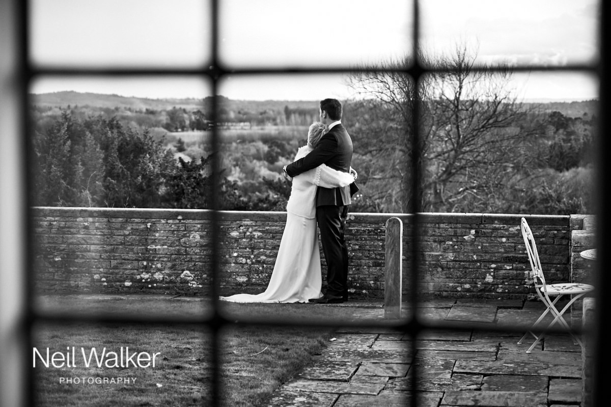 the bride and groom through a window at their Greyfriars House wedding