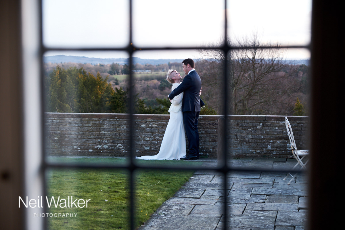 the bride and groom hugging on the terrace at Greyfriars House