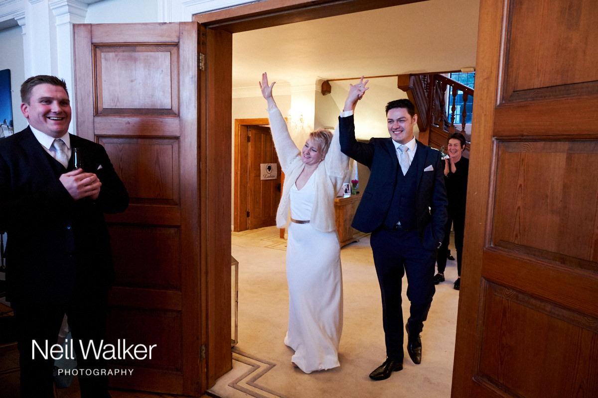 the bride cheering as she is announced into the wedding breakfast