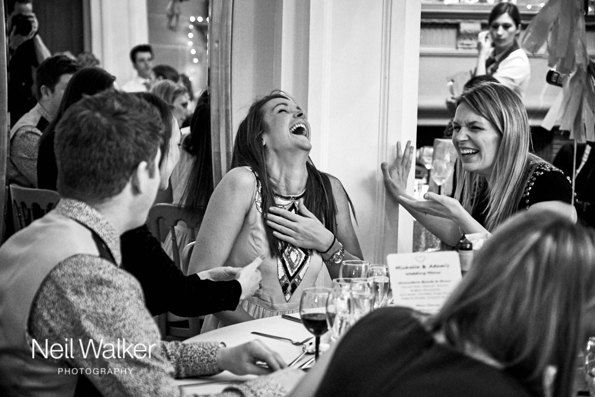 a guest laughing during a wedding meal