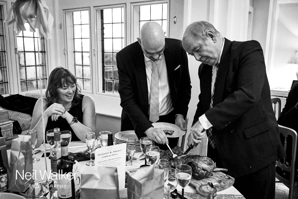 guests carving the wedding meal at their table
