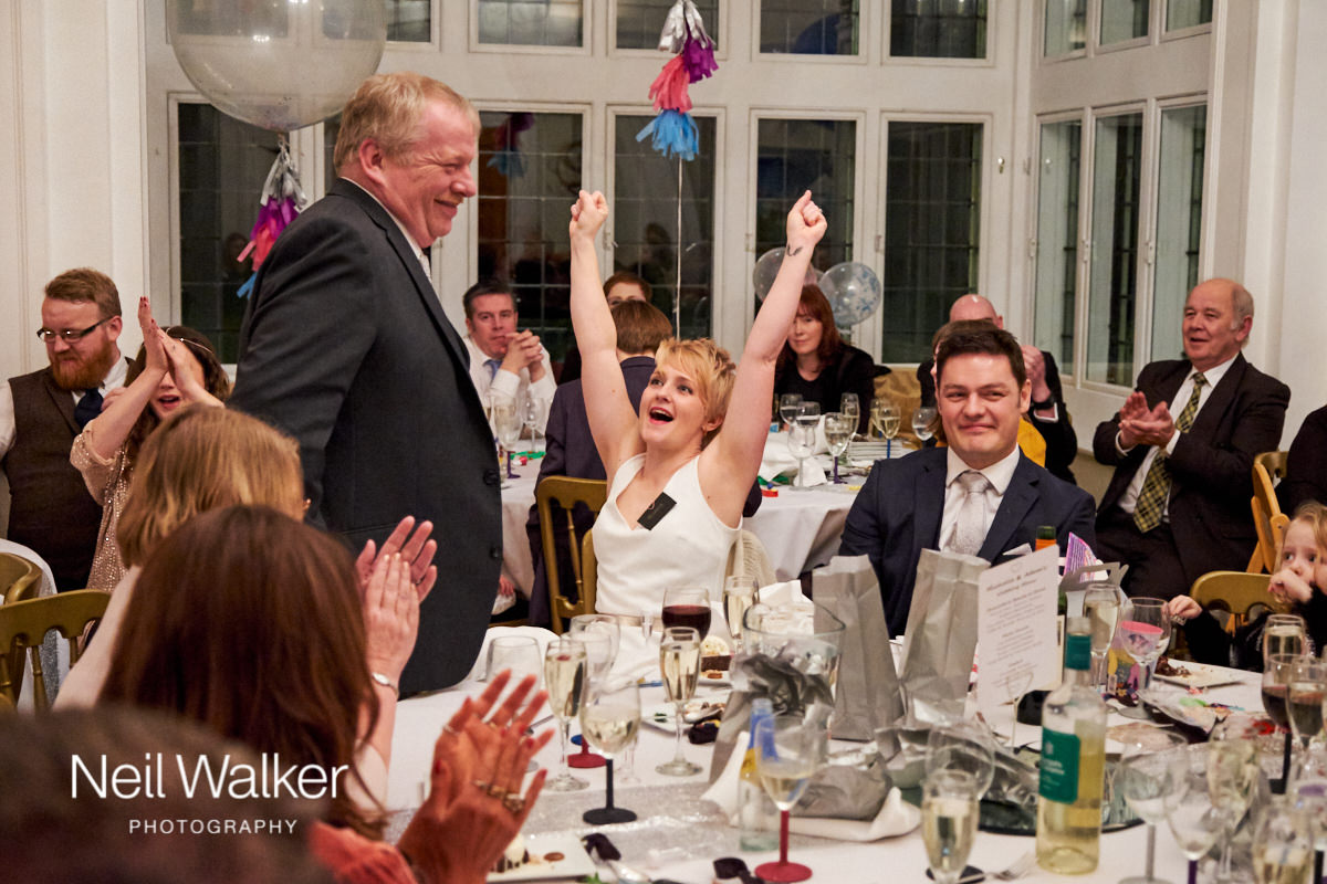 the bride cheering her father