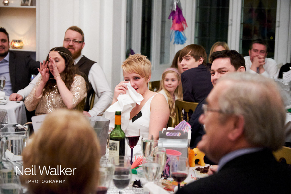the bride wiping away a tear during her father's speech