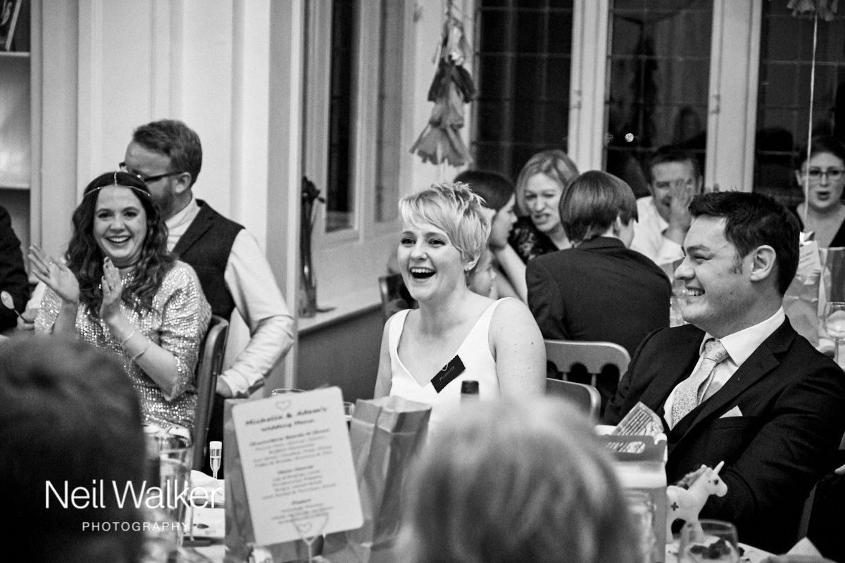 the bride laughing during her father's speech