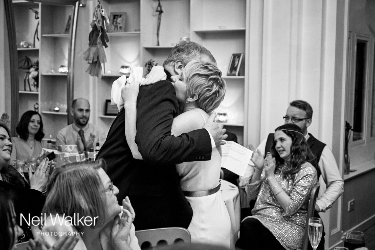 the bride hugging her father