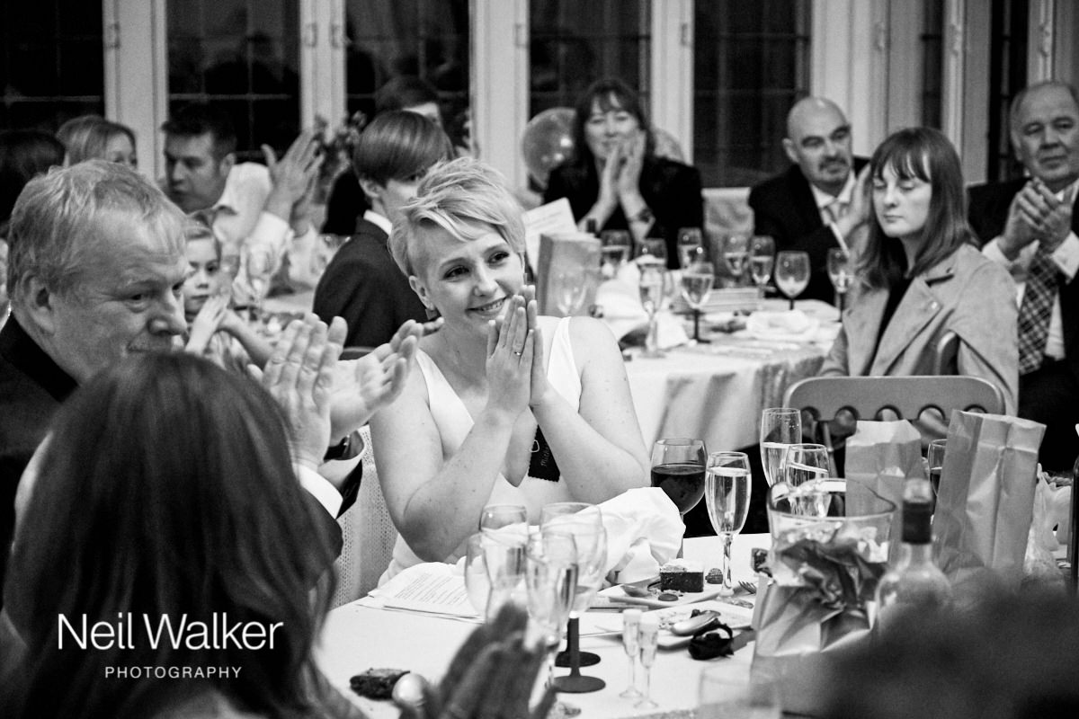 the bride looking adoringly at her new husband during his speech