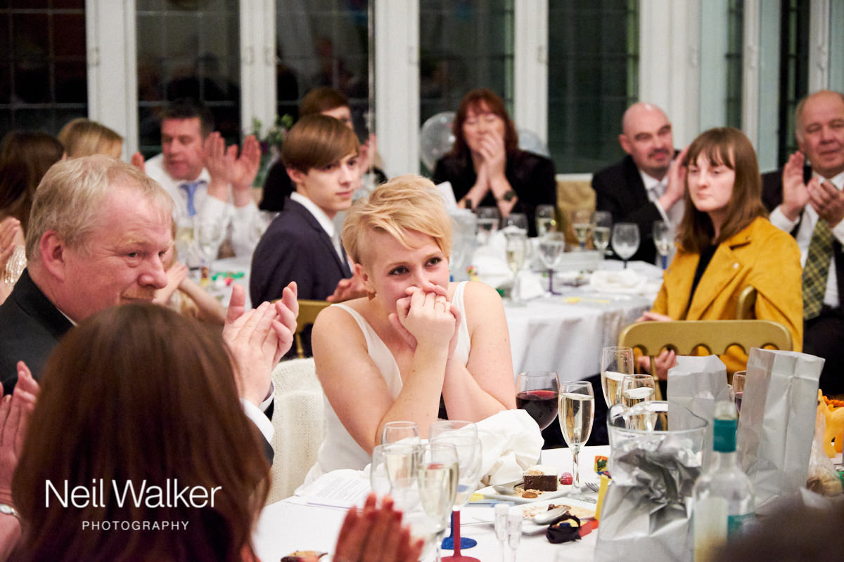 the bride watching her husband during his speech