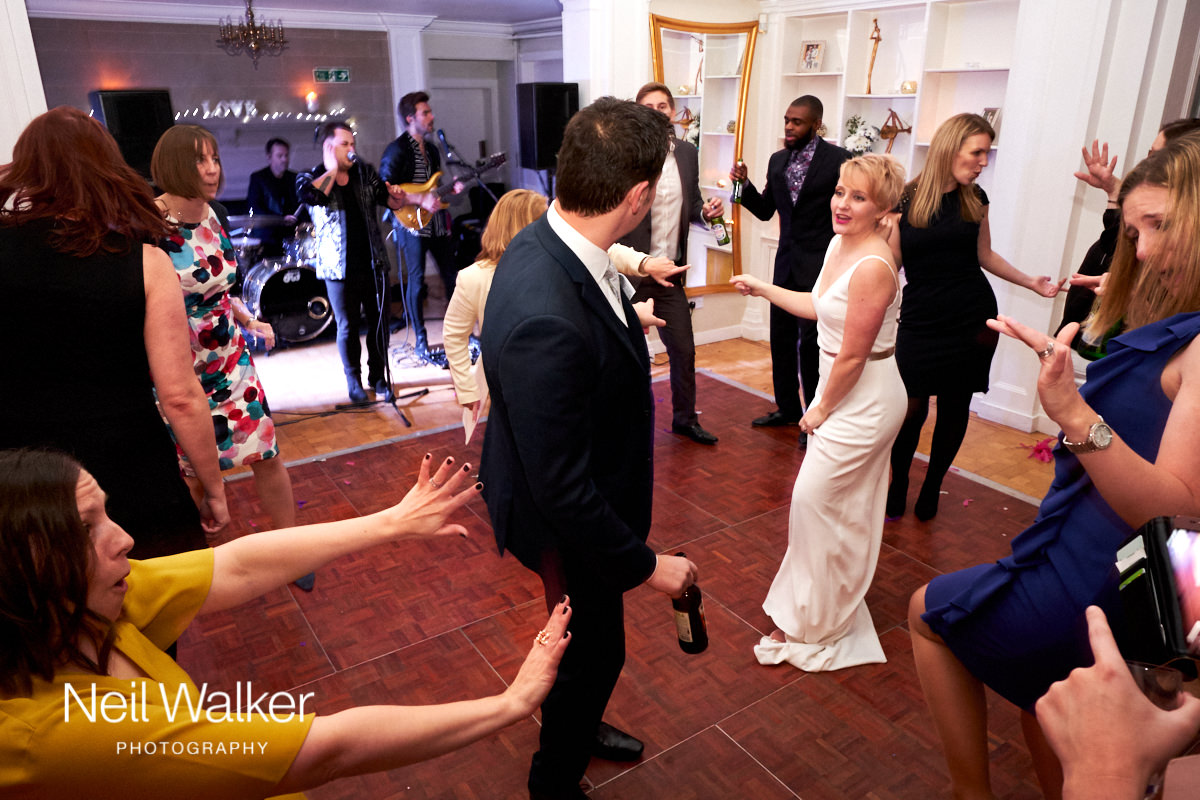 the bride and groom on the dance floor