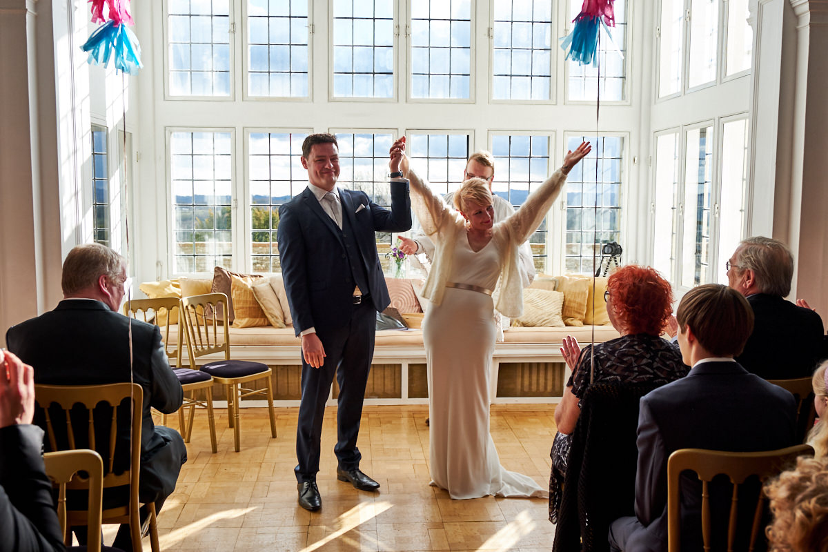 a bride and groom getting married at this Greyfriars House wedding