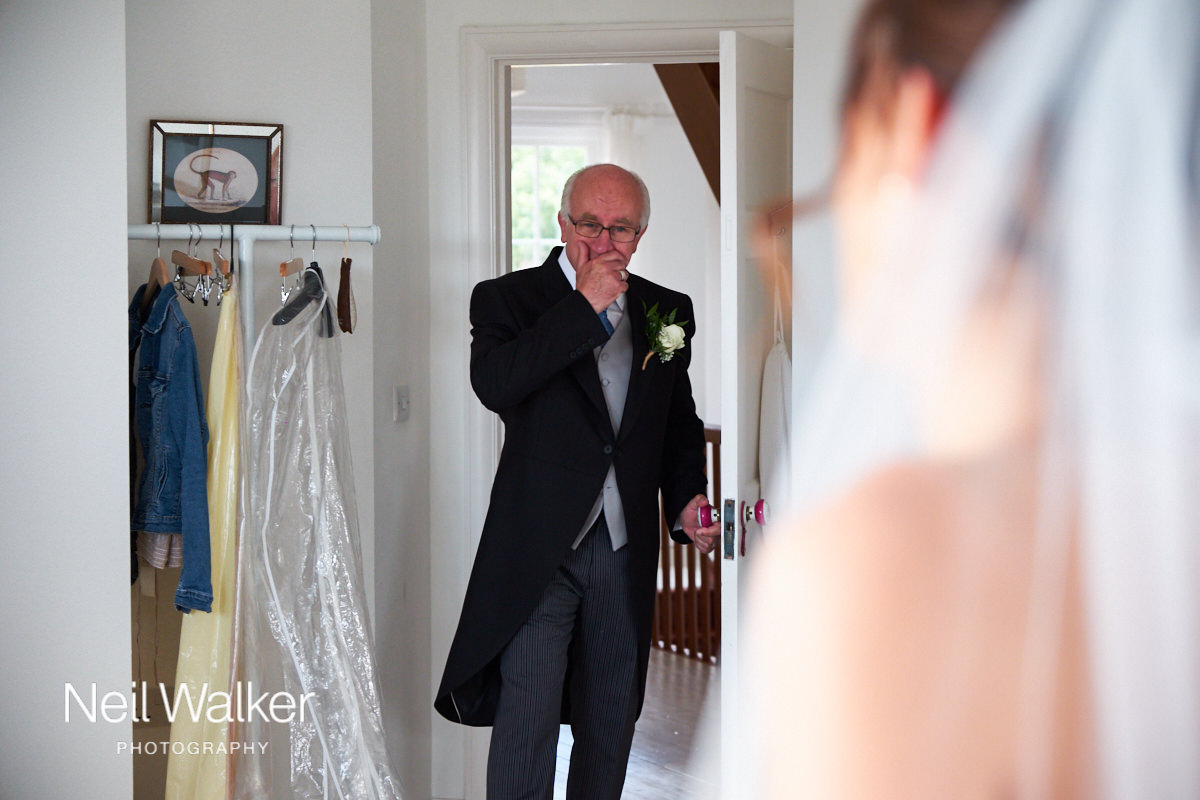 the bride's father seeing her for the first time in her wedding dress