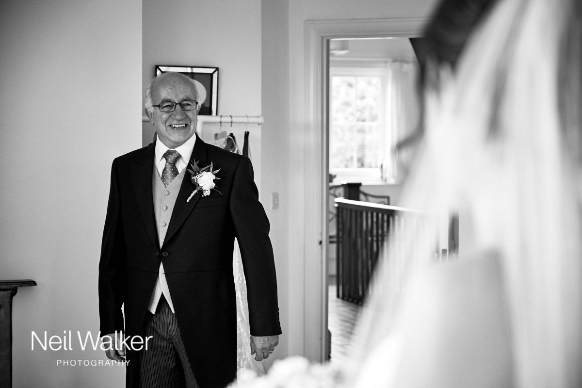 the bride's father smiling