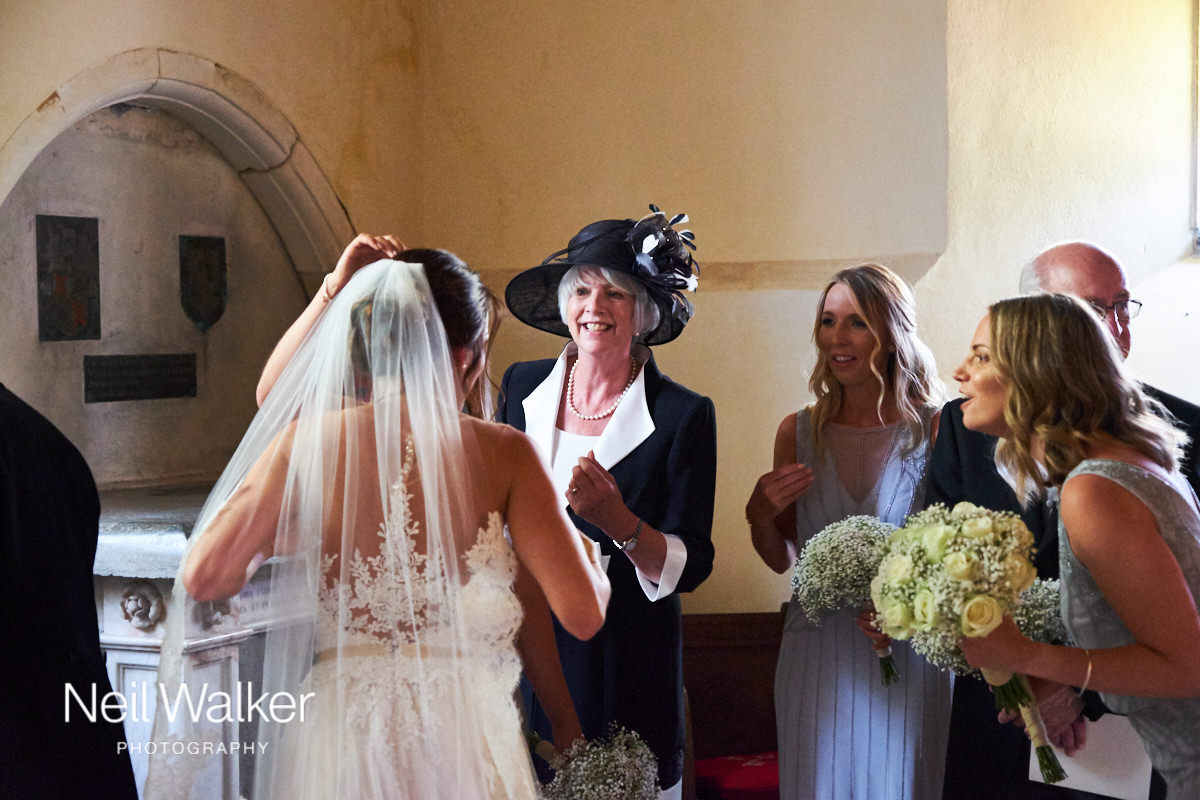 the mother of the bride congratulating the bride