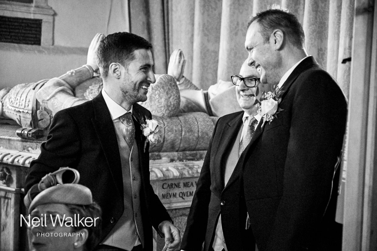 the groom laughing with his best man