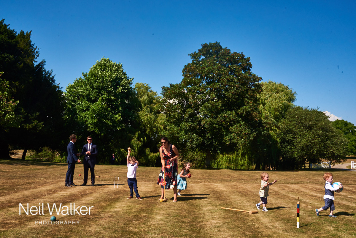 guests at the wedding paying croquet