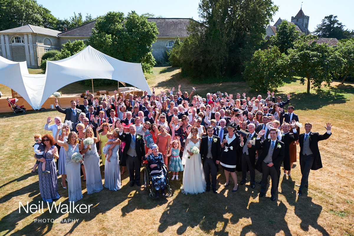 a big group photograph of a wedding
