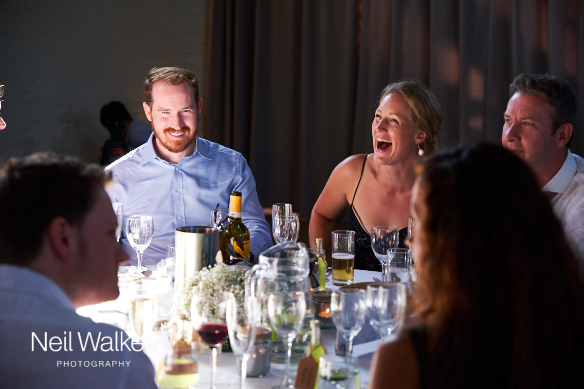 a guest at a wedding laughing