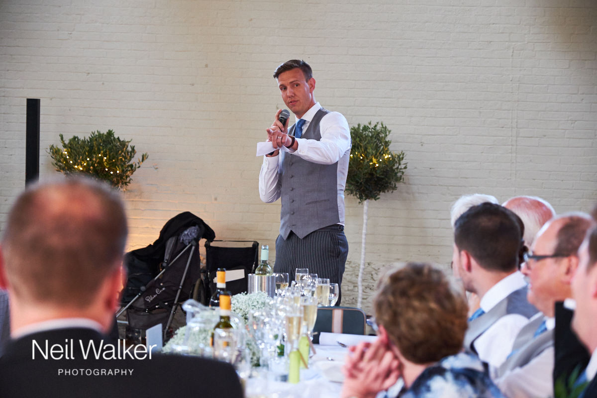 the master of ceremonies announces the speeches at a Sussex wedding