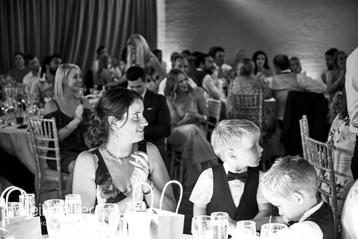 guests listen to speeches at a wedding