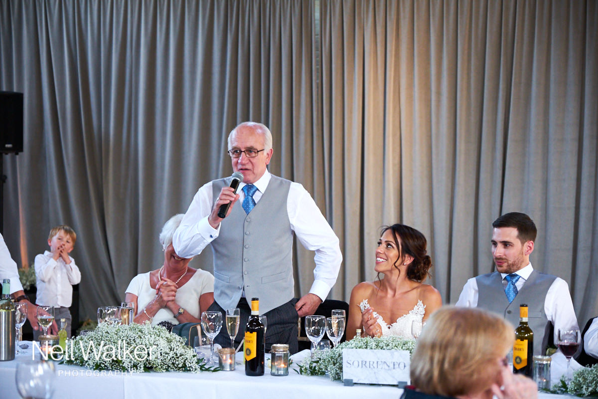 the father of the groom makes a speech at a Sussex wedding