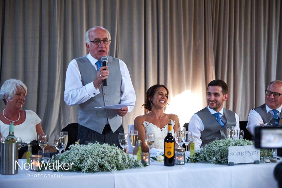 the bride laughs at the father of the bride speech