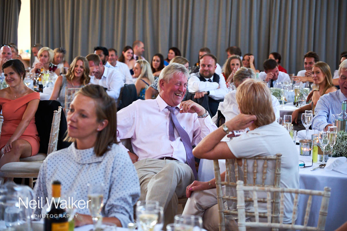 guests enjoying the speeches at a wedding