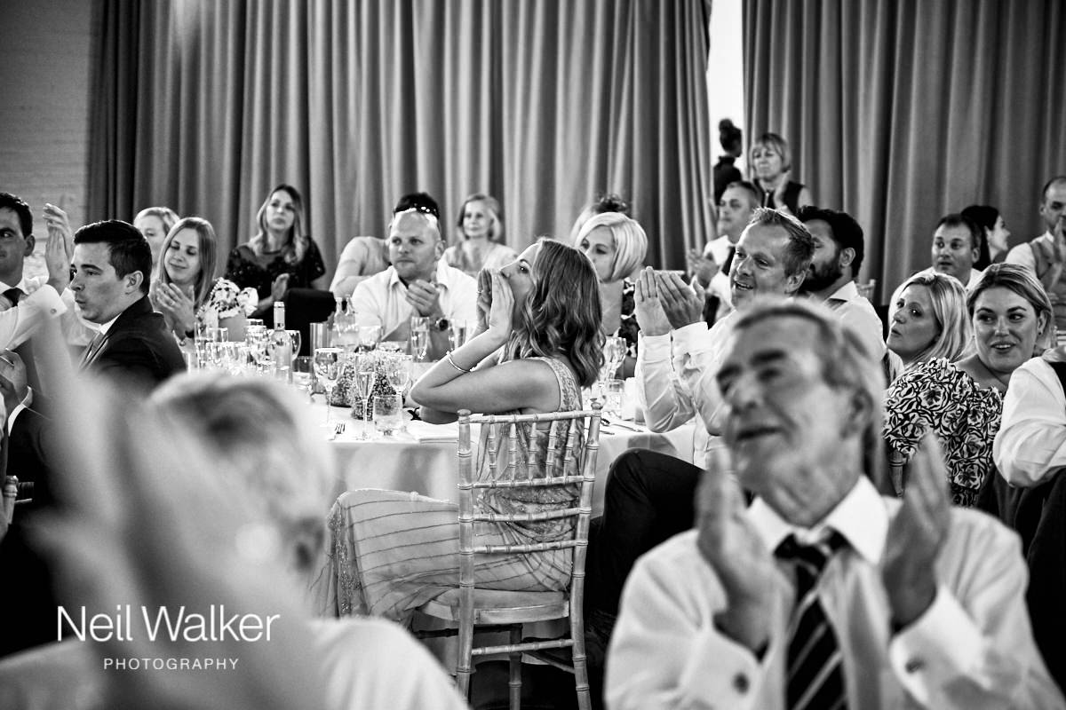 guests listening to wedding speeches