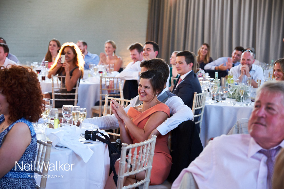 a guest clapping speeches at a wedding