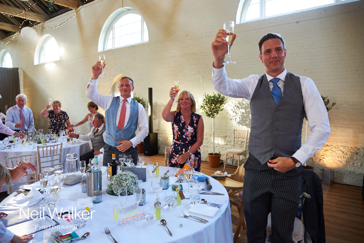 guests cheering at the Groom's speech