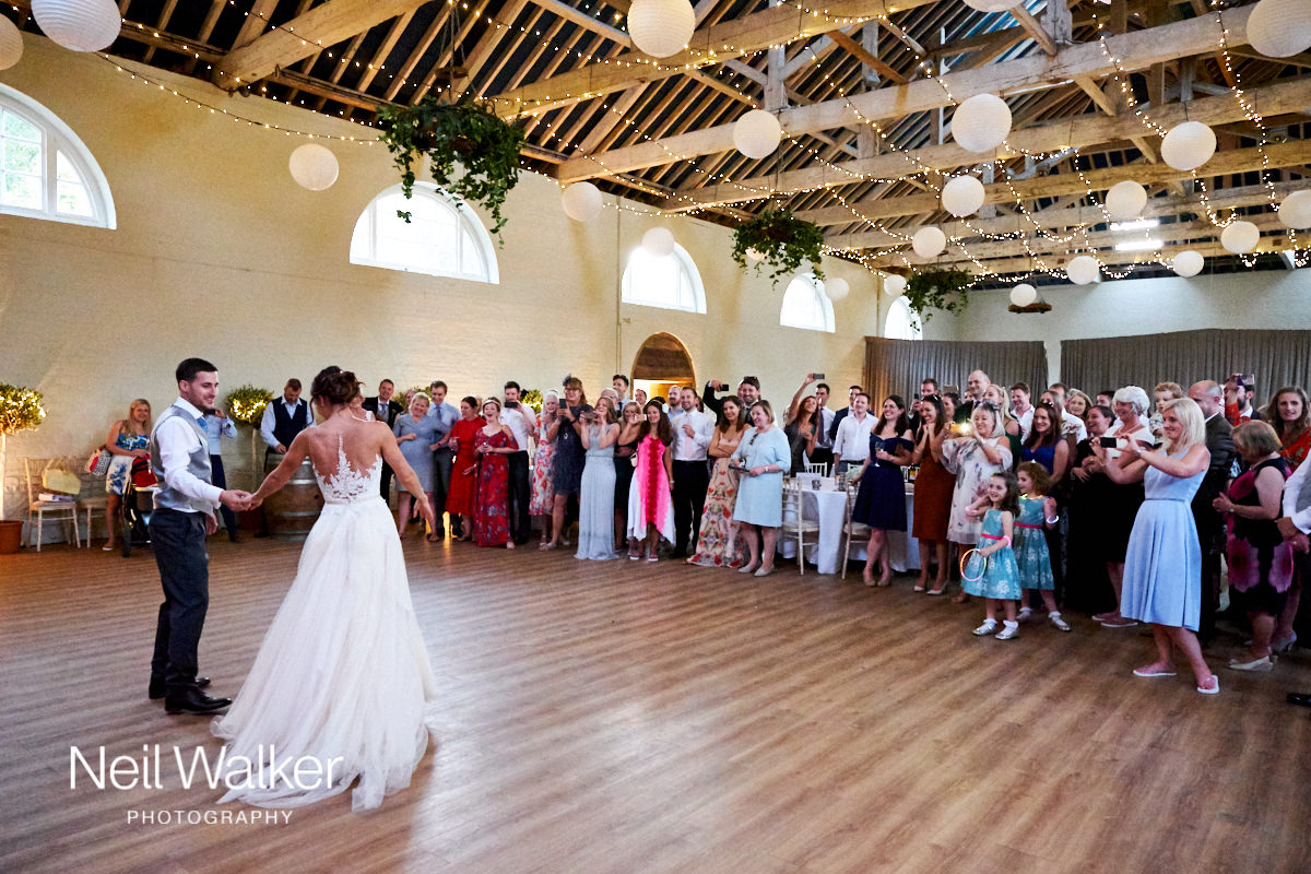 a bride and groom's first dance at the Georgian Riding School at Firle